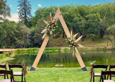 Outdoor Wedding Altar's Floral Decorations by Bloom Florist in Sonora, CA